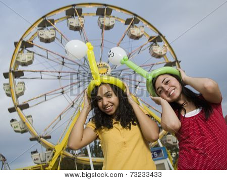 Multi-ethnic teenaged girls at carnival