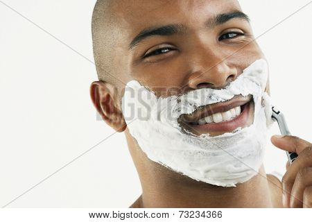 African man shaving face