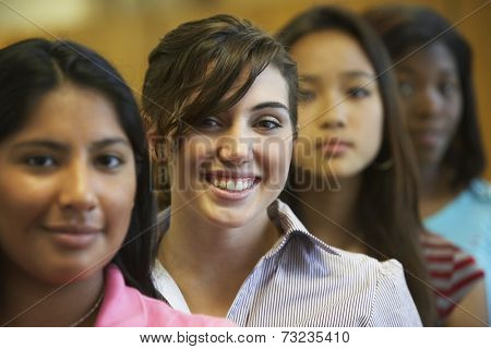 Multi-ethnic teenaged girls in row
