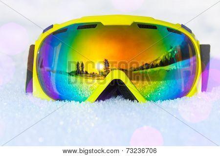 Yellow ski mask with reflection of landscape