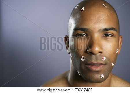 African American man with shaving cuts
