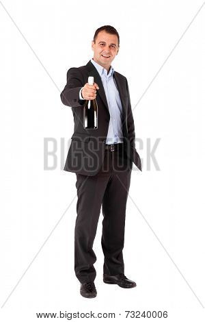 Businessman in a suit holding sparkling wine bottle. Isolated with work path.