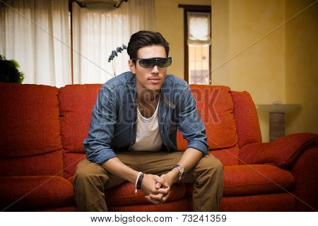 Young Man In 3D Glasses Sitting Watching Television