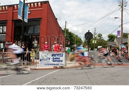 Group Of Cyclists Motion Blur In Turn Of Bike Race