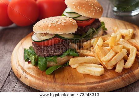 Mini hamburgers served with french fries, classic fast food