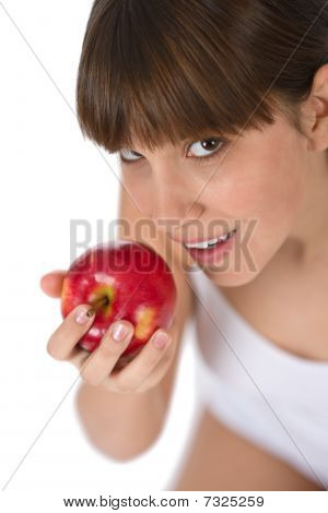 Female Teenager Eat Red Apple