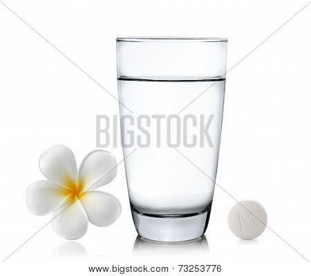 Glass Of Water Pills And Frangipani Flower Isolated White Background