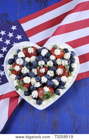 Patriotic Red, White And Blue Berries With Fresh Whipped Cream Stars In White Heart Shape Flag On Ru