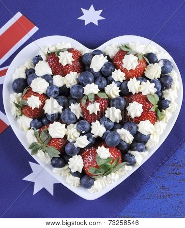 Red, White And Blue Theme Berries With Fresh Whipped Cream Stars In White Heart Shape Flag On Rustic