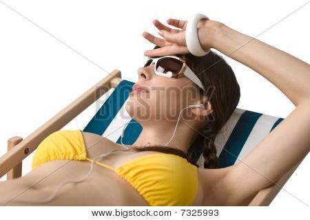 Beach - Woman With Ear Buds Relax In Bikini