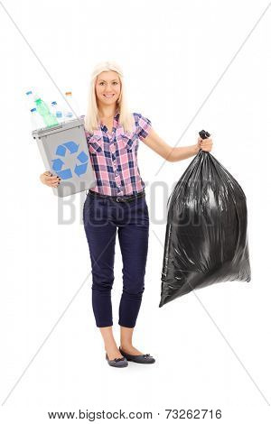 Full length portrait of a woman holding a recycle bin and a trash bag isolated on white background