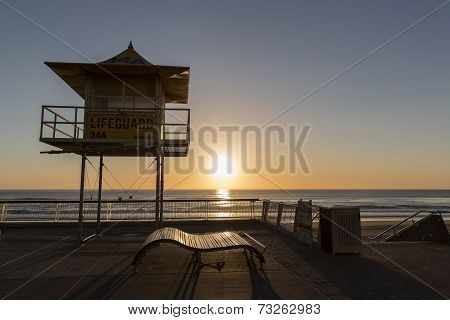 Gold Coast ocean sunrise and Lifeguard Tower silhouette