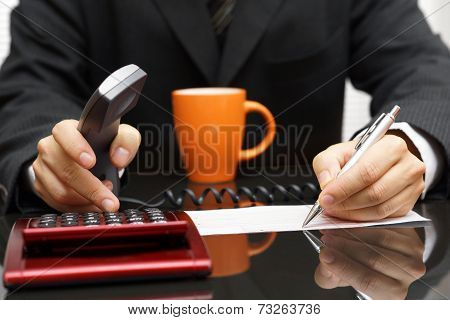 Businessman Is Fulfilling Document And Calculating With Headset In Hand Trying To Get Consultant On