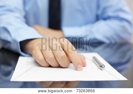 Businessman Show Client Where To Sign