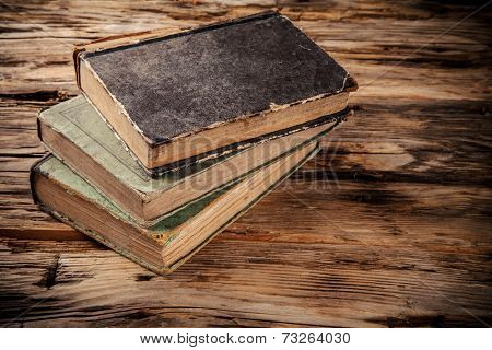 Pile of old books on wooden planks