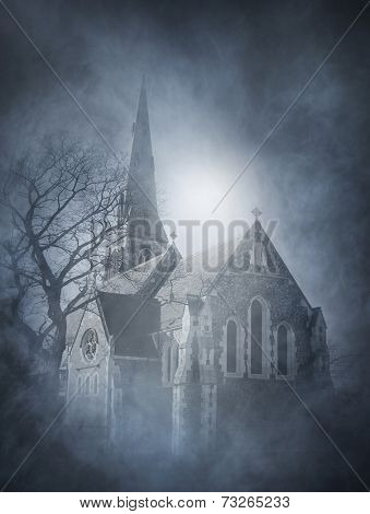 Halloween background with spooky and ancient church over smoky background
