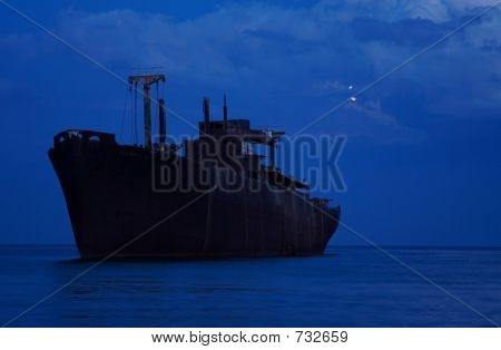 Rusty Shipwreck In The Pale Moon Light