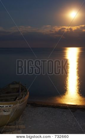 Fishing Boat On The Beach In The Moon Light