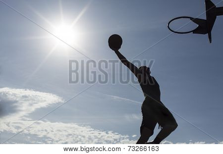 Basketball player silhouette slam dunking
