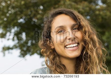 Attractive young woman laughing