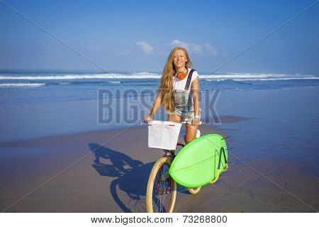 Surfer girl with a bicycle