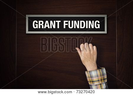 Hand Is Knocking On Grant Funding Door