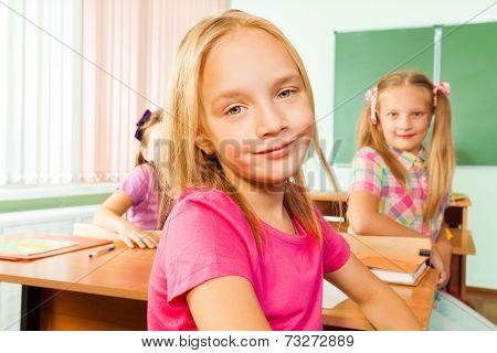 Cute girl looking sitting in classroom