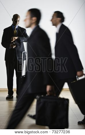 African businessman looking at watch