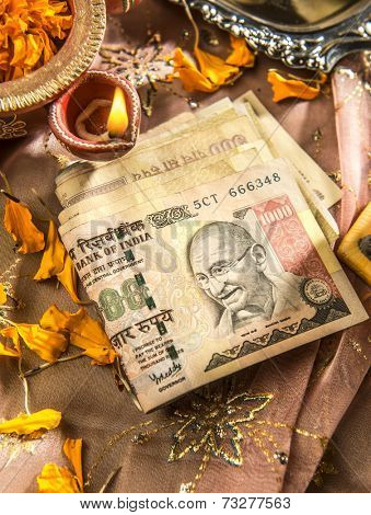 Indian currency notes with a traditional lamp. Currency is worshiped during Diwali festival as a God in India.