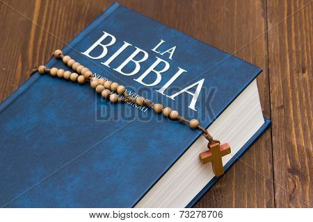 Bible On Wooden Table With Rosary