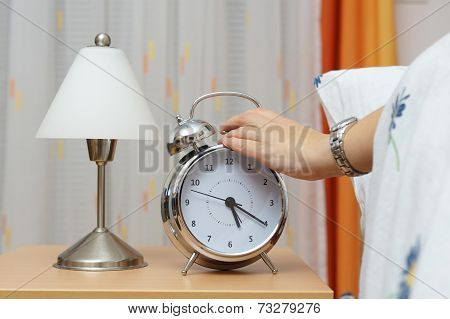 Alarm Clock With Woman  In Bed