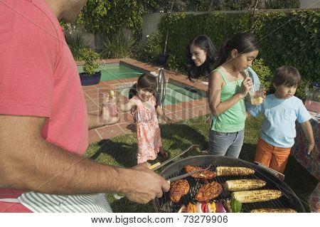 Hispanic family barbequing