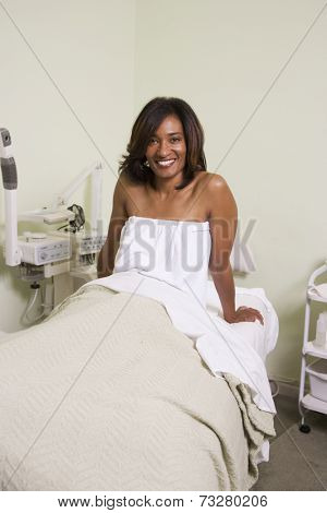 African woman on spa treatment table