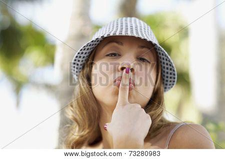 Hispanic woman kissing finger