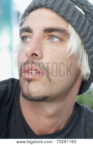 Hispanic man wearing wool hat