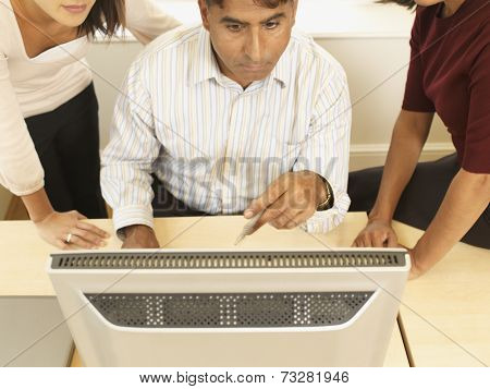 Multi-ethnic businesspeople looking computer