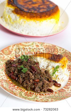 Iranian (Persian) herb and lamb koresh served with Persian saffron rice. The meat is slowly stewed with masses of parsley, coriande and scallions.
