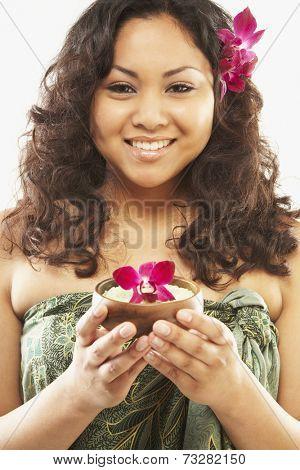 Pacific Islander woman holding bath salts