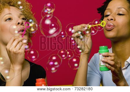 African women blowing bubbles