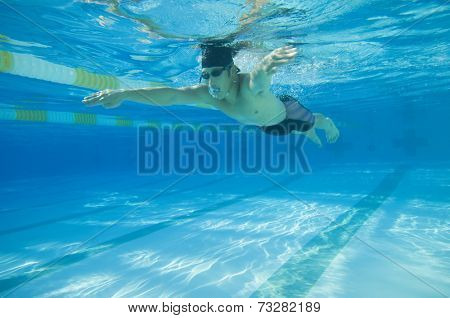 Underwater shot of Asian man swimming