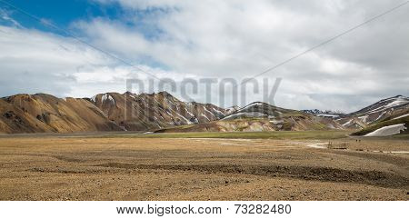 Blurred Tourists walking across Landmannalaugar unbelievable landscape, Iceland