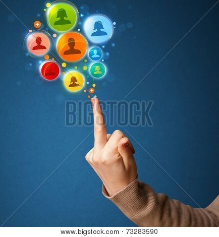 Social media icons coming out of gun shaped hand, social media concept
