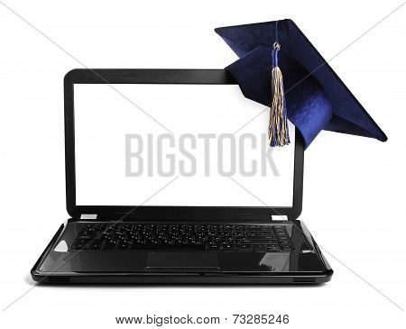 Laptop With Blank Screen And Education Student Cap