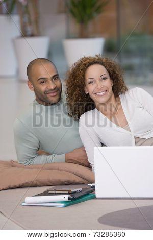 African couple working on floor