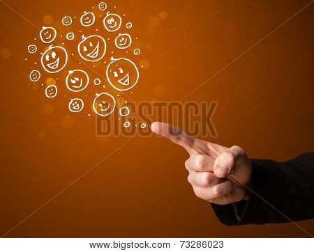 Group of happy hand drawed smiley faces coming out of gun shaped hands