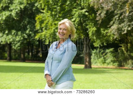 Happy Older Woman Smiling Outdoors