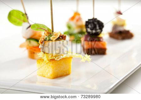 Seafood and Vegetables Canapes over White
