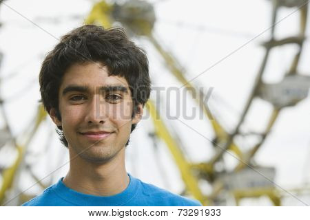 Mixed Race teenaged boy at carnival