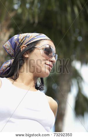 Hispanic woman wearing sunglasses
