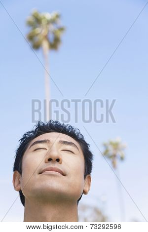 Asian man with eyes closed